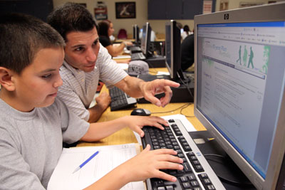 Guidance counselor working on computer